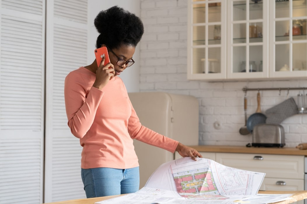 woman looking at house plans